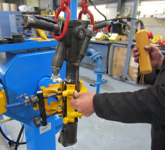 Moving the Jigger Pick into position for clamping within the fixture