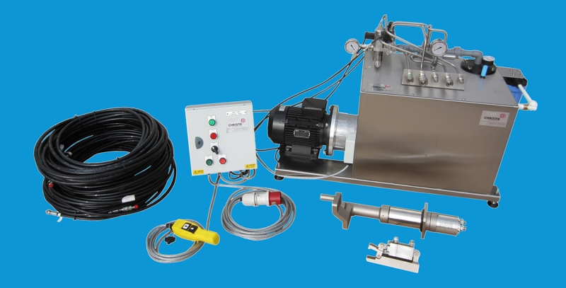The complete system: Water Hydraulic Torque Tool, Nut Arrestor, Control Panel, Stainless Steel Power Pack, and Hose Assembly.